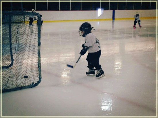 3 year old playing hockey