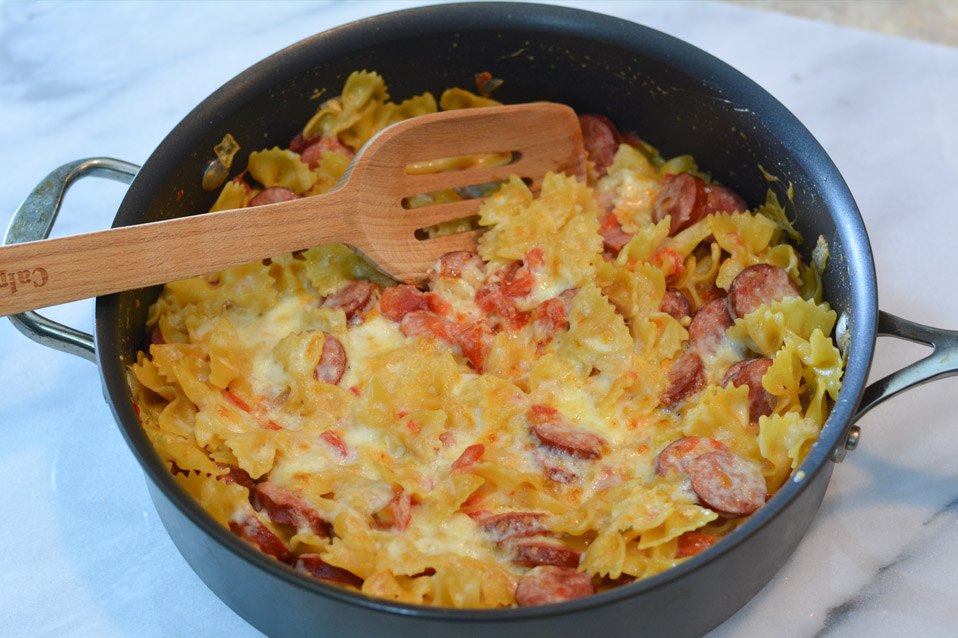 smoked sausage and pasta in large skillet