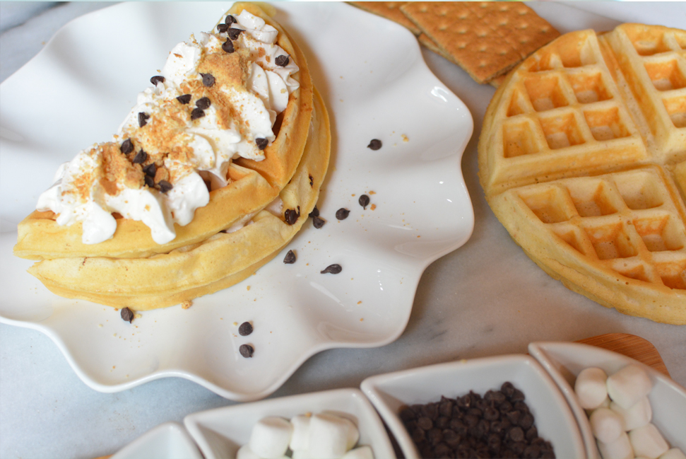 Satisfy your S'mores craving anytime with these S'mores Waffles. Start with a graham cracker waffle, stuffed with marshmallows and melted chocolate.