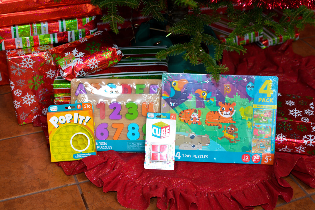 chuckle & roar puzzles under christmas tree